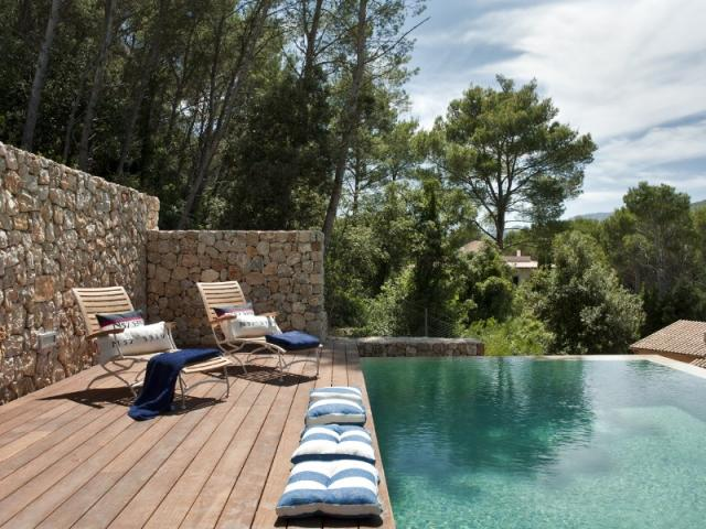 Infinity pool and sunny terraces overlook the gorgeous surroundings
