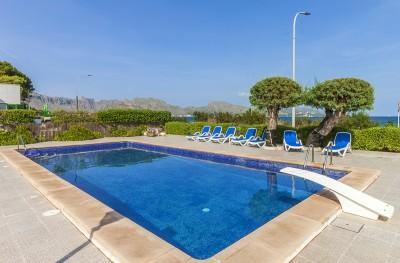 Seafront apartment with communal pool for sale in Puerto Pollensa, Mallorca