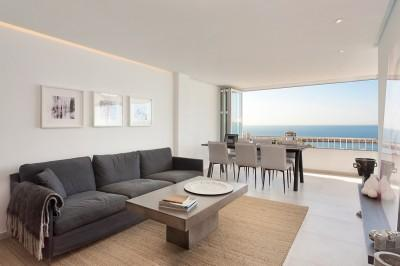 Living-dining area with sea views