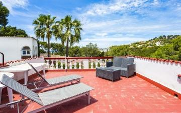 Fantastic town house with private garden for sale in Costa de la Calma, Mallorca